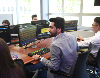 Adelphi business students working in the trading room