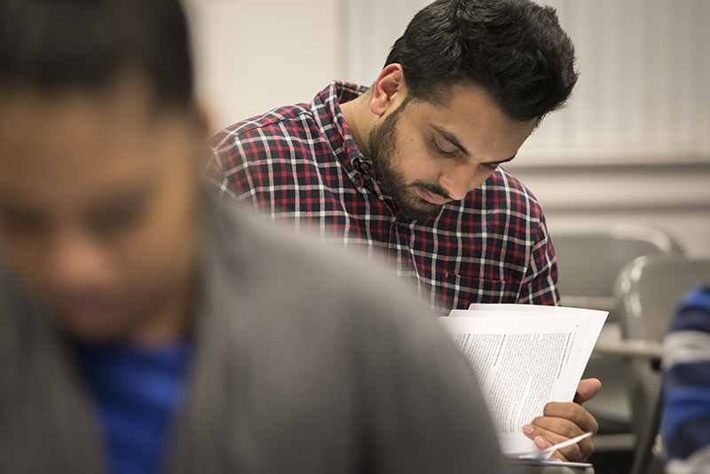 Adelphi business student focused during class.