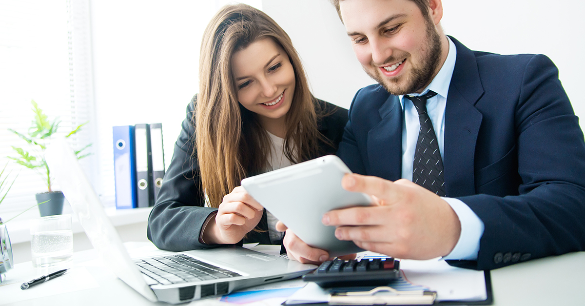 Two business students reviewing papers